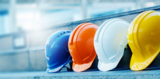 Multicolored Safety Construction Worker Hats. Teamwork of the construction team must have quality. Whether it is engineering, construction workers. Have a helmet to wear at work. For safety at work.